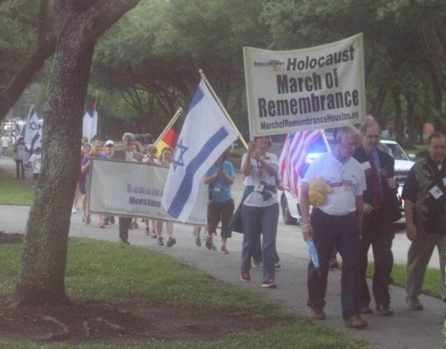 Marchers parade down West Lake Houston Parkway for the Holocaust March of Remembrance.
