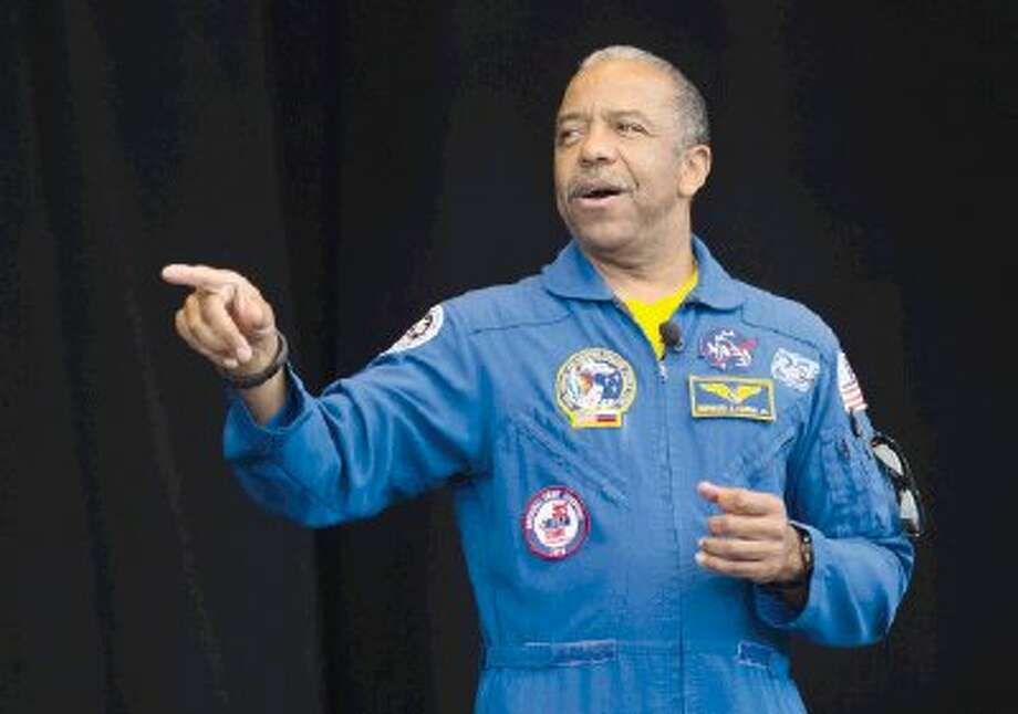 Dr. Bernard Harris, the first African American to walk in space, speaks during Musical Scores at The Cynthia Woods Mitchell Pavilion in The Woodlands Monday. More than 5,000 students and teachers from 33 different schools gather for the educational outreach program. The event was for academically at-risk students who earned the opportunity to attend the event by showing model behavior. Photo: Staff Photo By Ana Ramirez / The Conroe Courier/ The Woodland