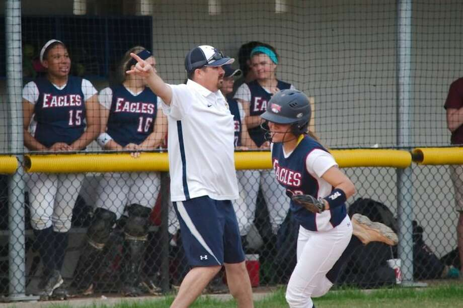 Dawson softball coach David McCorkle sends base runner Heaven Benavidez (13) home in a district game earlier this year. The Lady Eagles battle Ridge Point at 7:30 p.m., Friday in Manvel in a Class 4A playoff game. Photo: KIRK SIDES
