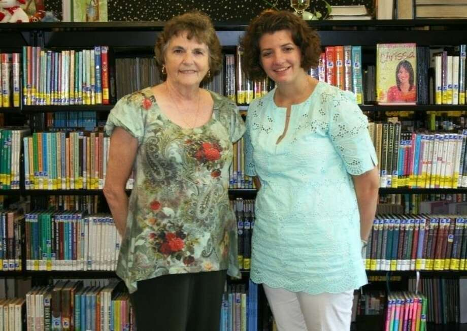 New Austin Memorial Library Children's Librarian Abby Hatton (right) took on the position after longtime librarian Pat Brooks (left) retired. Now she is focused on bringing fun to local children.