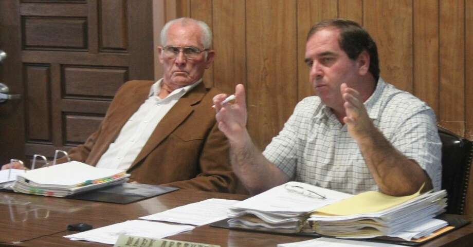 Pct. 4 Commissioner Mark Nettuno (right) expresses the need for documentation regarding Hay Meadow Lane's status as a county road. Photo: Jacob McAdams