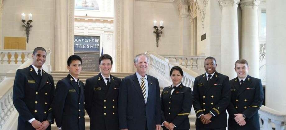 U.S. Rep. Ted Poe, center, with several students at the Naval Academy.