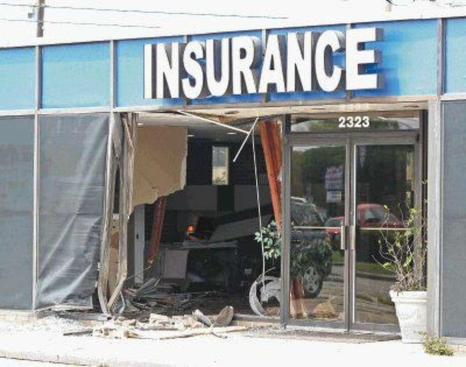 The damage left behind after a car crashed inside the Plemons Insurance Agency. Photo: Kar B Hlava