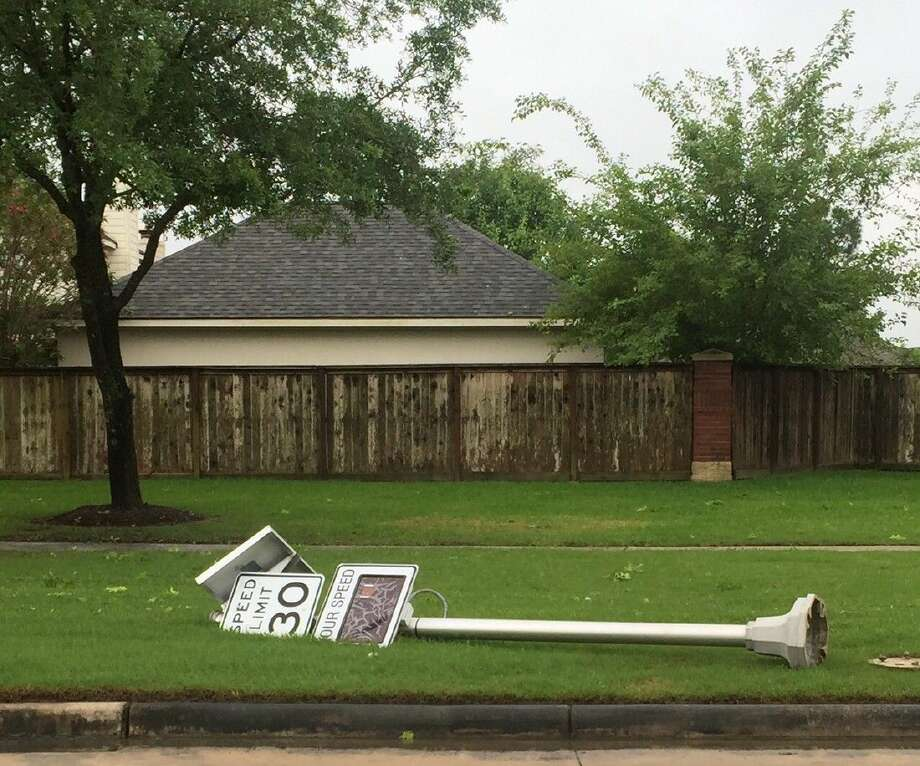 A street sign was knocked down along Magnolia in Pearland.