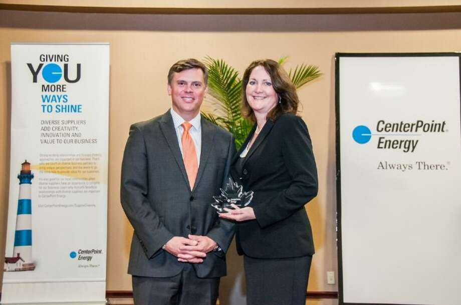 Diane Englet (right), senior director of Corporate Community Relations, with Scott Prochazka, President and CEO of CenterPoint Energy. Photo: Submitted Photo