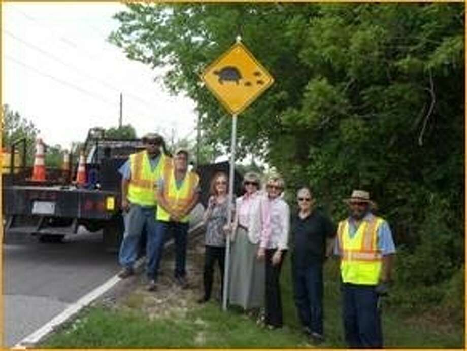City staff and Missouri City residents Dolores and Theresa Tarlton, center, pose with one of the City's new turtle crossing signs at Watts Plantation and Diamond Springs Road. Photo: Photo Courtesy City Of Missouri