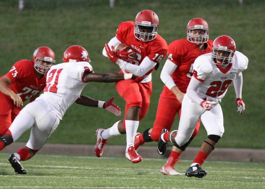 Dulles' Shemar Thurman runs against the Alief Taylor defense during their district game Oct. 3 at Mercer Stadium in Sugar Land. To view or purchase this photo and others like it, go to HCNPics.com.
