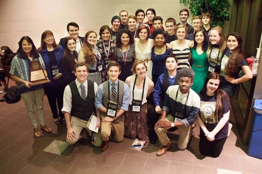 The cast and crew of Blue Stockings celebrates advancing from the UIL Area One-Act Play competition to the UIL Region III One-Act Play contest on April 25. Photo: Greg Andrews 2014