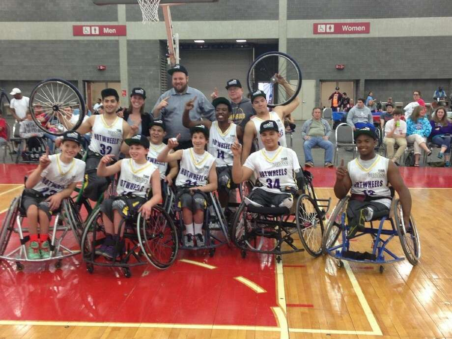 The TIRR Memorial Hermann Junior Hotwheels national champions are, from left, front row; Dustin Stallberg, Aaron Berry, Peter Berry, Angel Palomares and Carrington Marendes. Middle row; Fabian Romo, Abraham Hausman-Weiss, Daquan Minor and Victor Meza. Back row; assistant coach Ava Skrabanek, head coach Trice Ham, equipment manager Mark Sheehan.