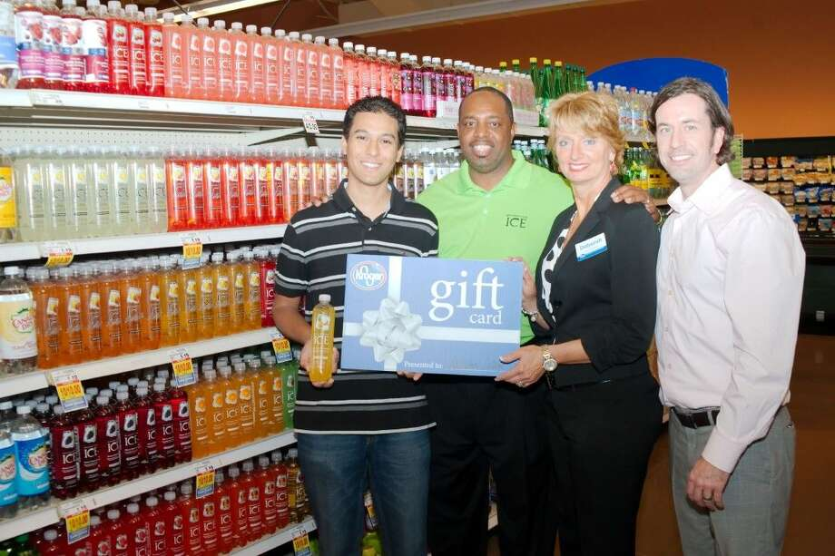Adrian Islam, left, is presented a gift card for $10,400 in free groceries from Kroger after winning the Sparkling ICE Shelfie Sweepstakes. Standing with Islam are left to right, Sparkling Ice Market Manager Marcus Jordan, League City Kroger Store Manager Deborah Hilton and Sparkling Ice Director of Sales Joshua Arrinton Tuesday, April 14.