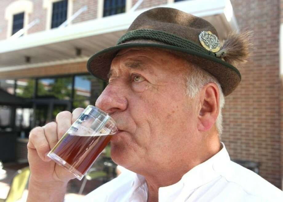 Peter Heinze from Miesbach, Germany, samples some beer at last year's Katy Wild West Brewfest. Photo: Alan Warren