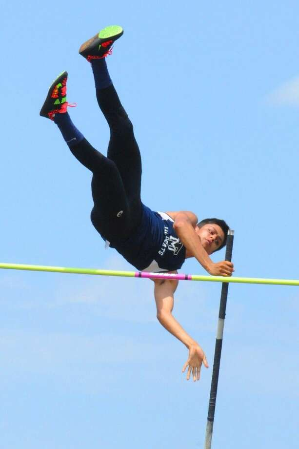 Memorial's Antonio Ruiz attempts to clear the bar. By the end of the day, he had a gold medal in the pole vault. Photo: Tony Gaines