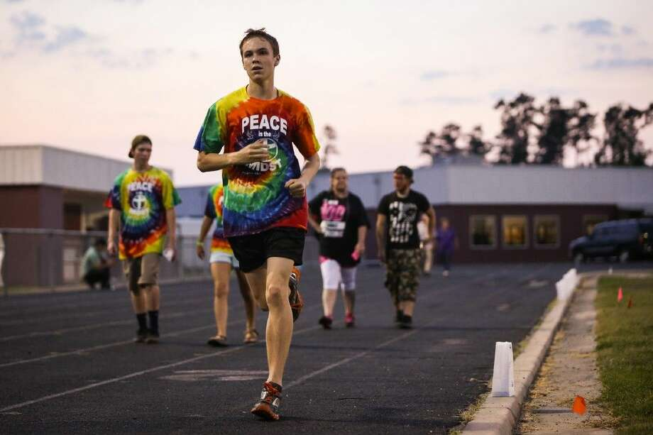 Zekaryah Wells runs during Relay for Life Magnolia in 2014 at Magnolia Junior High. The 2015 event will be held on April 24 from 6 p.m. to midnight.