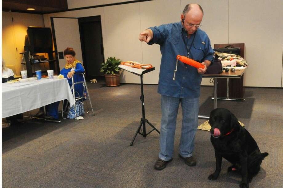 "Hank Hough of Kingdom Dog Ministries prepares his dog ""Prophet"" to go fetch to demonstrate obedience on Tuesday, April 14, 2015."