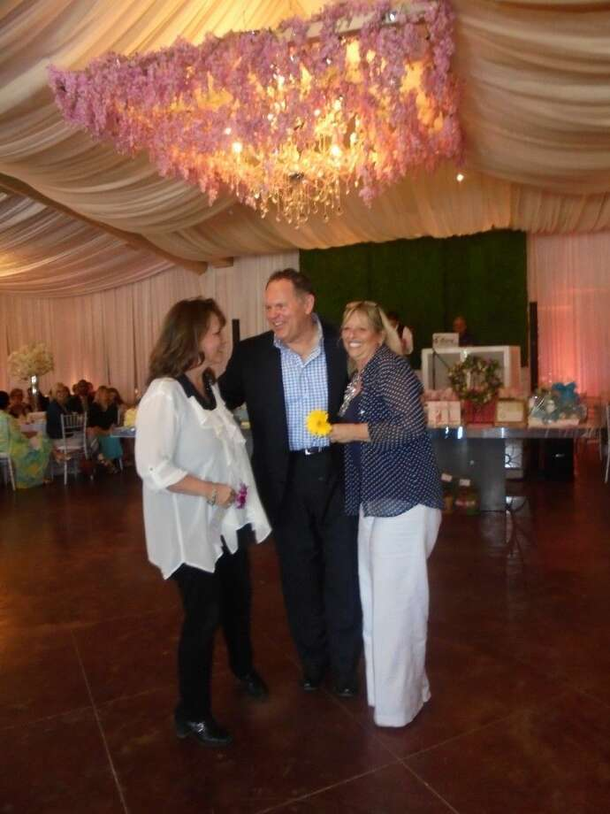 Greater Tomball Area Chamber of Commerce President Bruce Hillegeist congratulates winners of the auction item Lunch with the Chamber President at the TBPW annual Spring Style Show on Sunday, April 19.