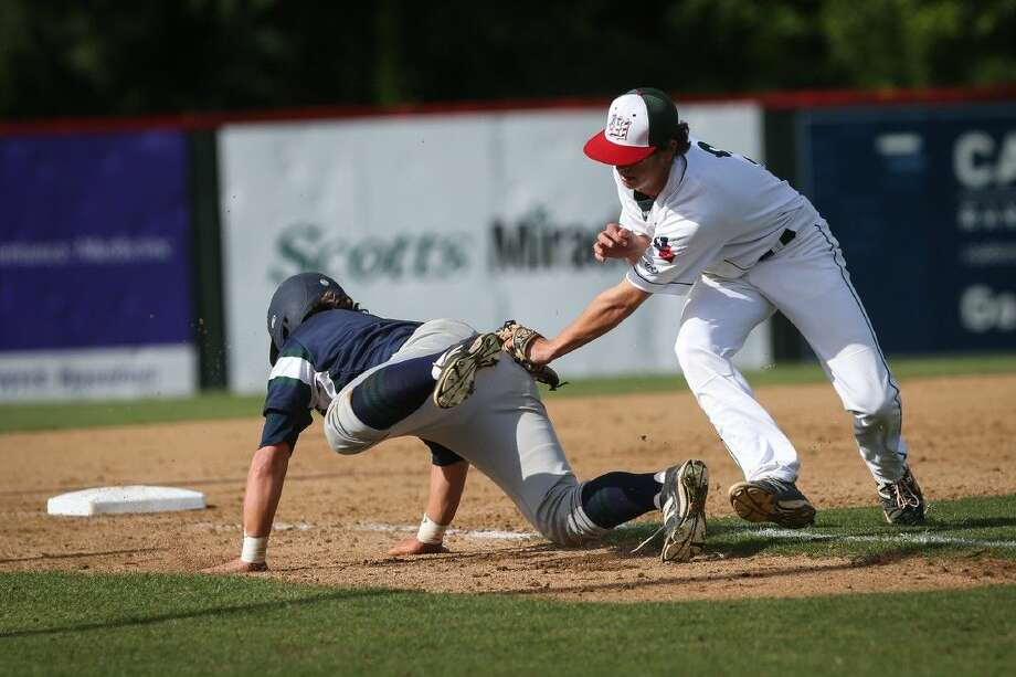 The Woodlands' Justin Diehl (3) tags College Park's Ryan Dufrene. To view more photos from the game, go to HCNPics.com.
