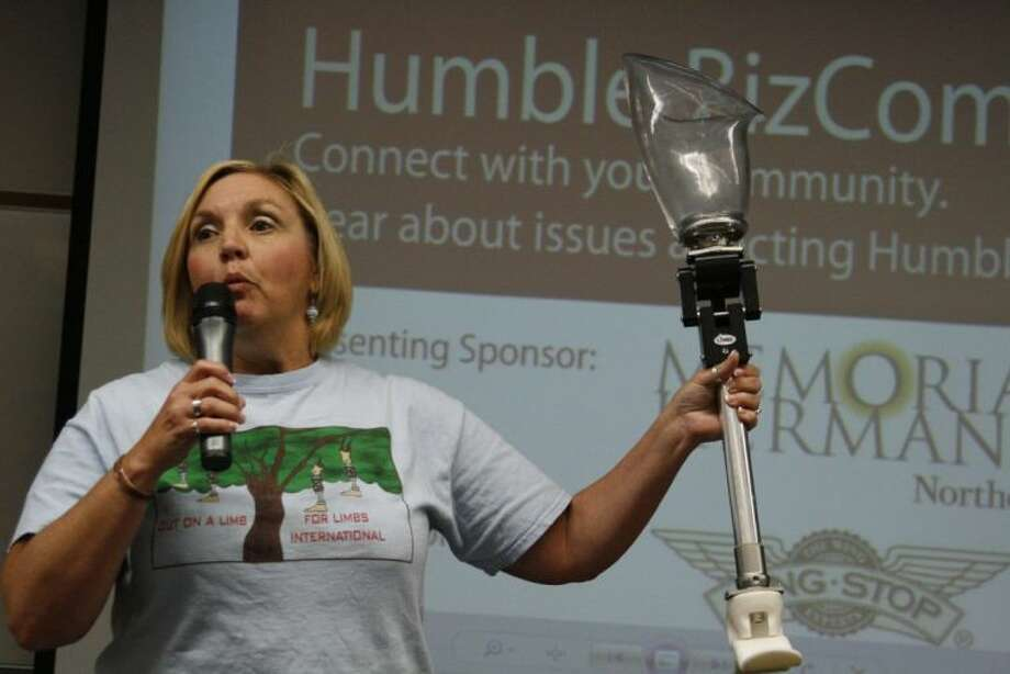 Stacey Hamlet, IB Creativity Action Service (CAS)/Service Learning Coordinator, showcases the prosthetic legs the LIMBS International provides to amputees in third world countries.
