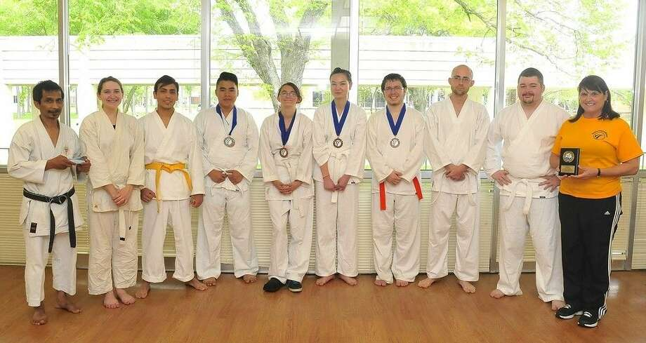 Pictured (left to right) are Sensei Deddy Mansyur, karate instructor; San Jacinto College tournament volunteer Angela Olson; San Jacinto College karate competitors Justin Cevallos, Thanh Dinh, Danielle Geisel, Laura Pon, Jason Hartenstein, and Anthony McIntyre; San Jacinto College tournament volunteer Richard Homer; and Sandi Morgan, San Jacinto College physical education department chair. Photo credit: Jeannie Peng-Armao, San Jacinto College marketing, public relations, and government affairs department.