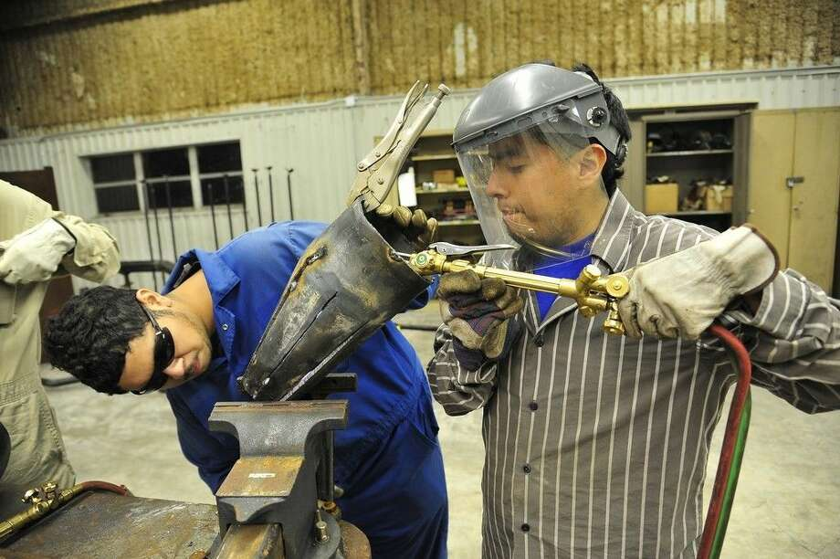 Pictured (left to right) Jose Jaimes and Jorge Gonzalez work on eccentric reducers in a San Jacinto College pipefitting class. San Jacinto College offers noncredit courses that certify people with the National Council for Construction Education and Research (NCCER) in the areas of welding, electrical, pipefitting, construction, and more. Photo credit: Rob Vanya, San Jacinto College marketing, public relations, and government affairs department.