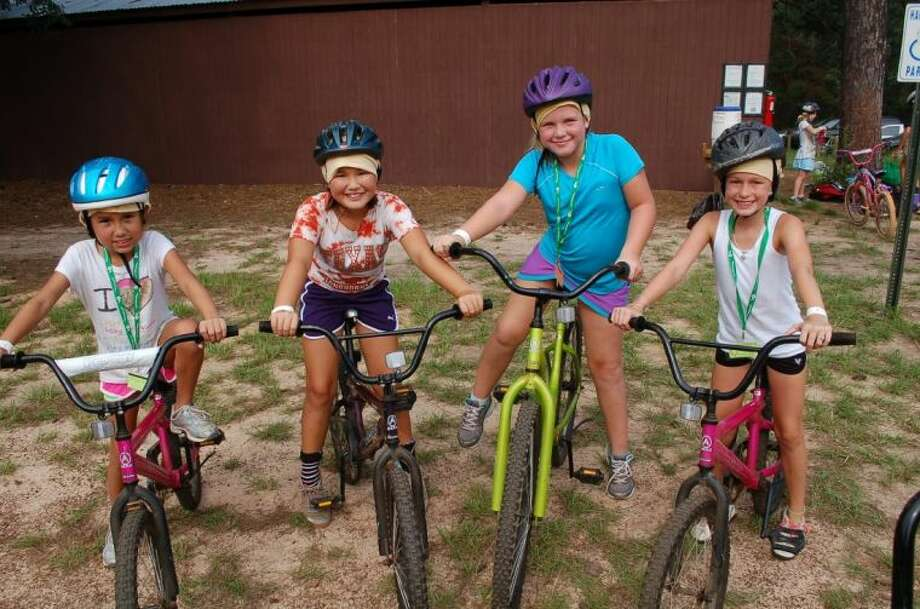 Biking is just one of the many activities campers can enjoy during their time at resident camp. Those looking for a more rugged venture could opt for the Extreme Adventure Session where campers have the chance to climb Enchanted Rock, tube down the Comal and later visit New Braunfels to continue the action-packed session. Every girl in southeast Texas, age 6-17, can spend a week at GSSJC's resident camps this summer - they do not have to be a current member of Girl Scouts. For more information, visit www.gssjc.org/residentcamp. Photo: Submitted Photo