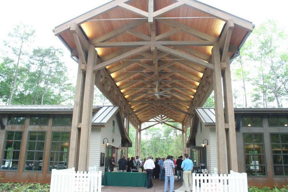 The Groves' Welcome Center features a pavilion overlooking a large outdoor plaza, fire pit, grill and expansive lawn area for casual recreation and community-wide events
