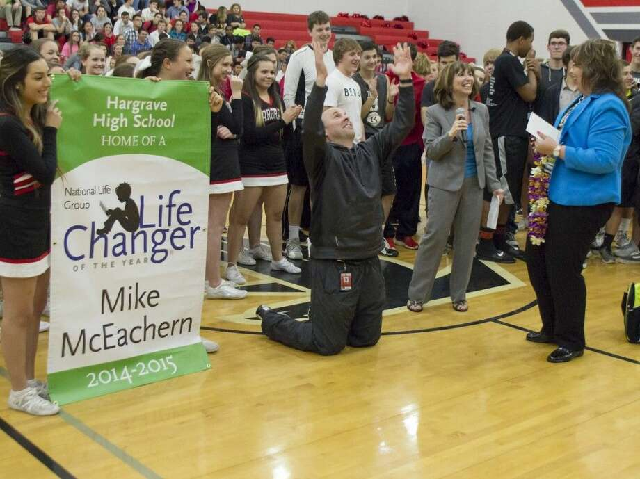 During a surprise pep rally, Mike McEachern learned he was a finalist for the LifeChanger of the Year award and would be traveling to Hawaii.