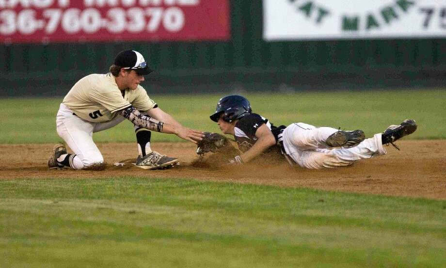 Conroe second baseman Dawson Shibley tags out Summer Creek's Brent Wisenbaker as he tries to stretch a hit into a double in the third inning of a District 16-6A baseball game Tuesday. To view or purchase this photo and others like it, visit HCNpics.com.