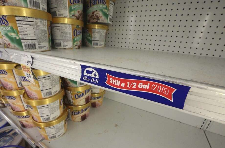 Shelves sit empty of Blue Bell ice cream at a grocery store in Dallas, Tuesday.