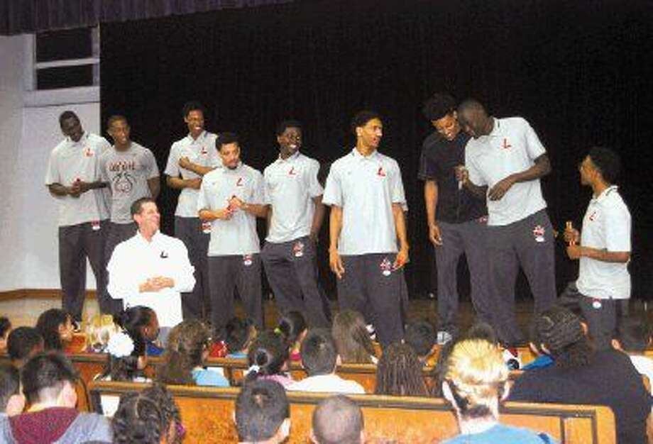 Head Coach Roy Champagne and members of the Lee College Basketball Team recently visited Carver Elementary School in Baytown, where they passed out pencils and offered words of encouragement as students prepared to take the STAAR test.