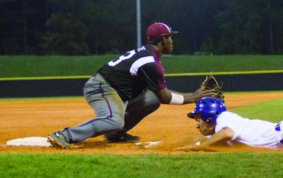 Magnolia's Jarel McDade (23) waits for the ball as Dayton's Josh Eckerman (2) slides safely back to third base during game one of the area playoff series at The Woodlands Christian Academy Thursday, May 8. To view or purchase this photo and others like it, visit HCNpics.com. Photo: Staff Photo By Ana Ramirez