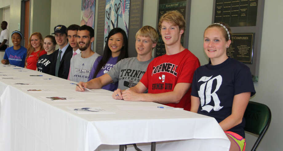 The John Cooper School Athletic Department held a signing ceremony May 8 to recognize 10 senior athletes who will be competing at the college level in the fall. Seated, from left, are Sonia Johnson and Lindsay Hale, who will play soccer for DePaul University and Cornell University respectively. Christopher and Donald Avant, who will play basketball at Emory University; Caroline Sands, who will fence at the University of Pennsylvania; Jacob Stelter, who will run for Westminister College; Katie-Li Walker, who will swim at College of the Holy Cross; Gordon Allan, who will swim for Trinity University; Ryan Sharkey, who will swim for Cornell University and Carly Pratt, who will swim at Rice University. Photo: Courtesy Photo