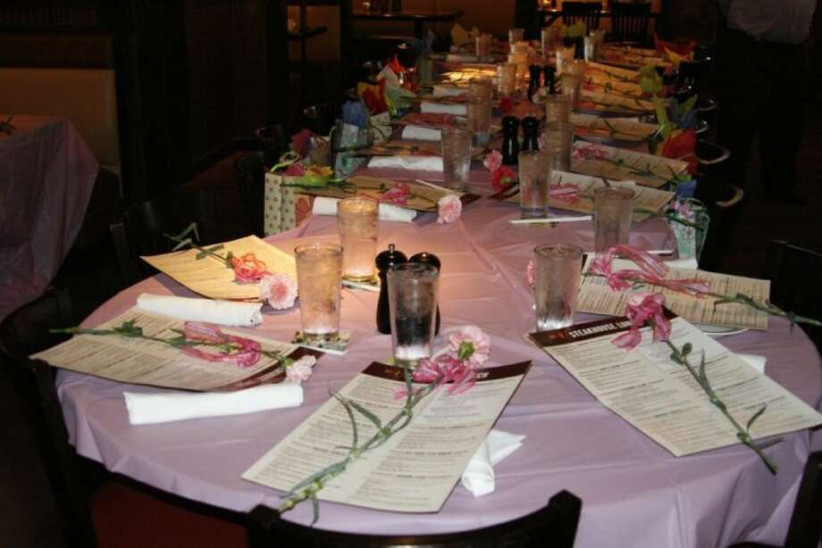 With a special pink carnation placed at each of their seats and special Mother's Day gift, women from FamilyTime Crisis and Counseling Center's shelter, The Door, had a special lunch at Humble's LongHorn Steakhouse.