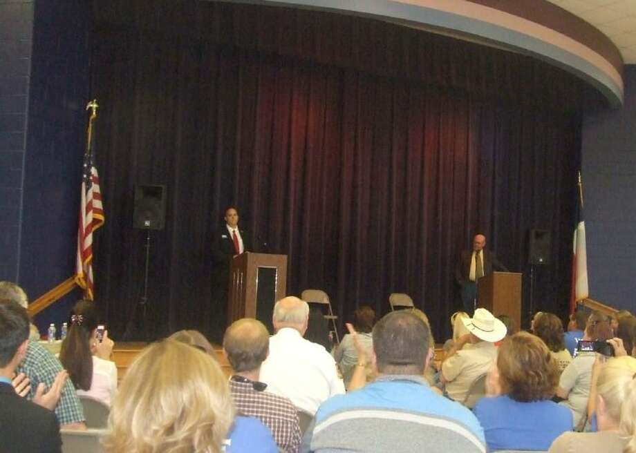Rob Harmon, left, and Charlie Riley, candidates for Montgomery County Commissioner Precinct 2, debate during a forum sponsored by the Chambers of Magnolia Legislative Alliance on May 6. Photo: Lindsey Vaculin