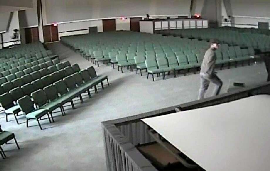 Video surveillance shows the suspect wearing a black hat, jeans and a long-sleeved shirt entering the building.