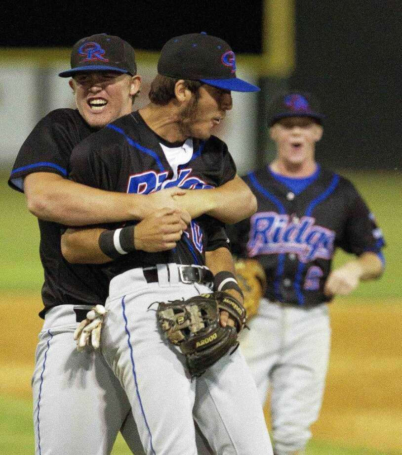Oak Ridge celebrates after their 4-1 victory over College Park to win the District 16-6A title Tuesday. To view or purchase this photo and others like it, visit HCNpics.com.