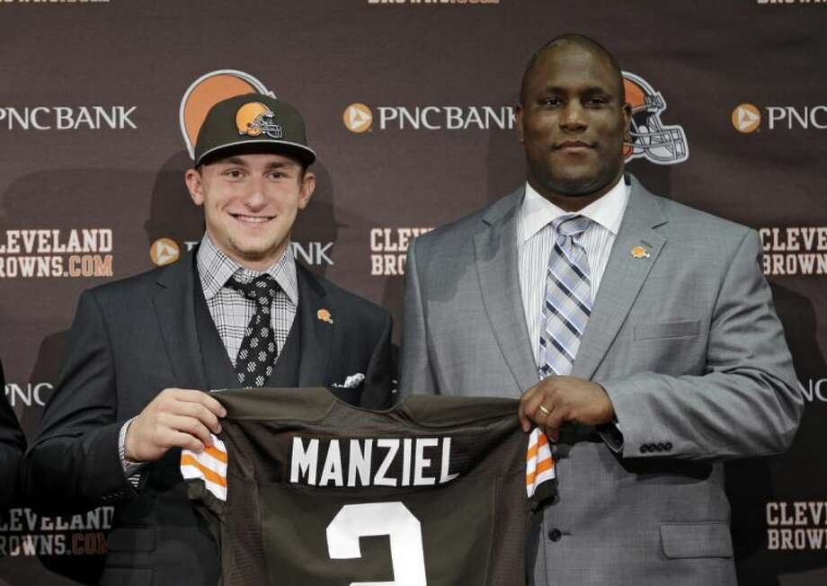 Browns quarterback Johnny Manziel sports his new jersey with the team's general manager, Ray Farmer.
