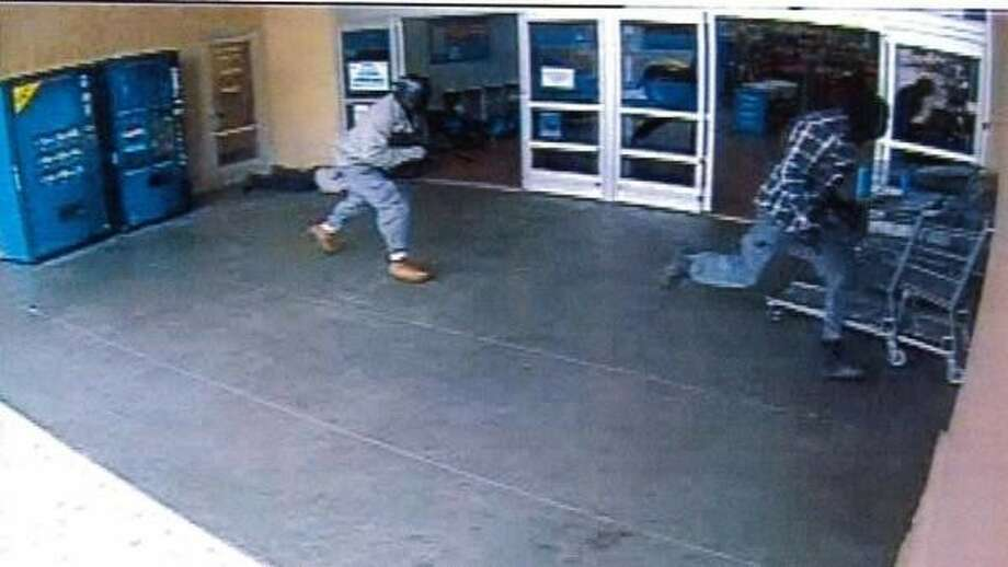 In the second image, both suspects are seen fleeing on foot. Photo: Courtesy Pearland Police Dept.