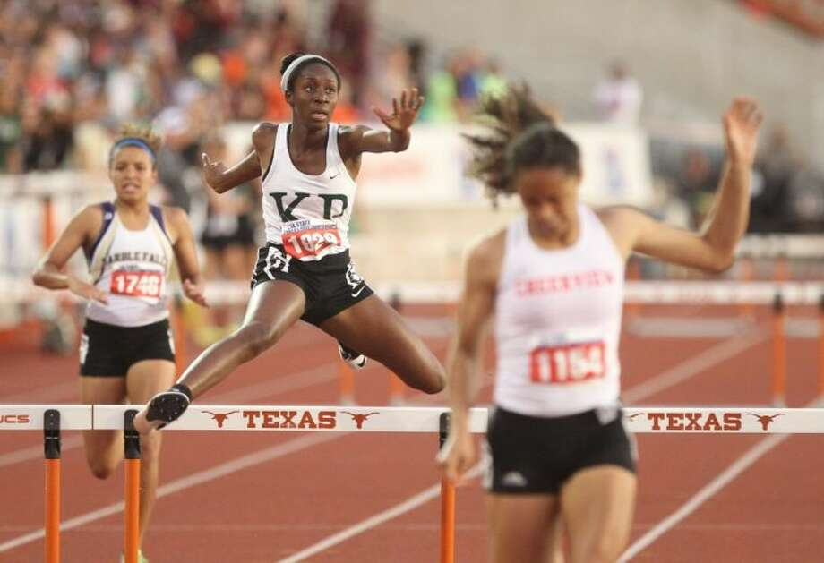 Kingwood Park's Friddaus Amadu competes in the Class 4A girls 200 meter hurdles during the UIL State Track and Field Championships at Mike A. Myers Stadium in Austin Friday. To view or purchase this photo and others like it, visit HCNpics.com. Photo: Jason Fochtman
