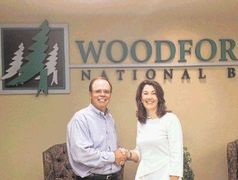Robert E. Marling, left, chairman and chief executive officer of Woodforest Financial Group Inc., congratulates Cathleen (Cathy) Nash, who was named Woodforest National Bank's president and chief executive officer.