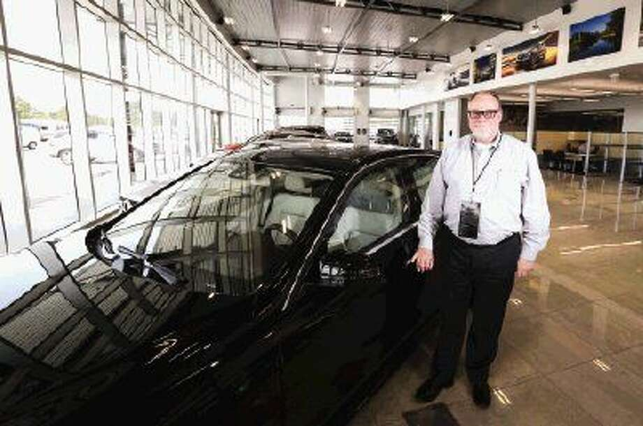 Co-owner Bob Milner poses for a portrait at the new Mercedes-Benz of The Woodlands during its official opening to the public Monday. Photo: Michael Minasi