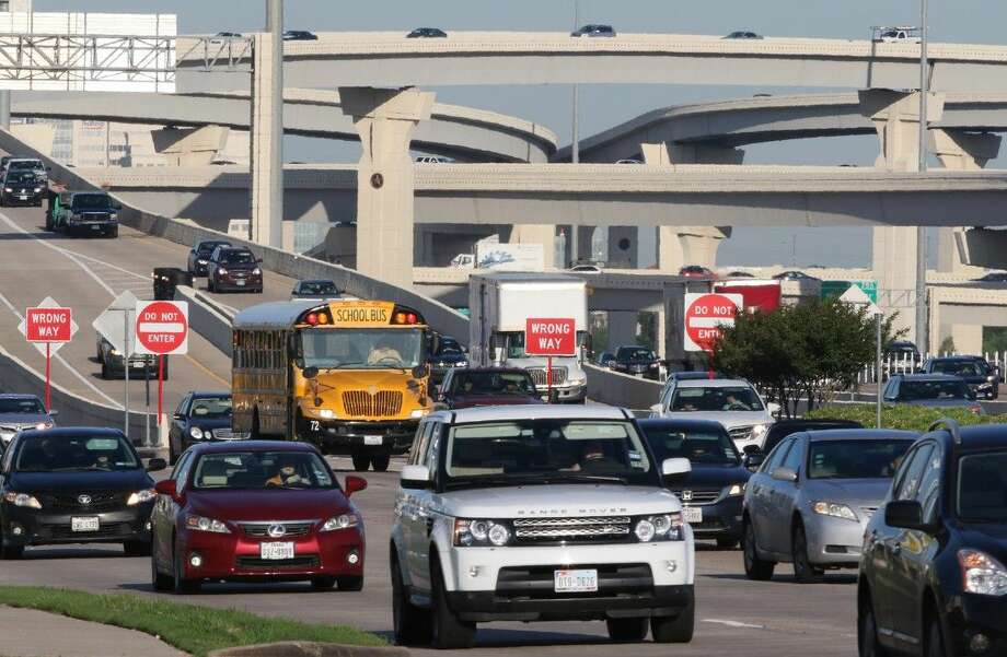 Rush hour traffic moves along the I-10 feeder road near Gessner Road and Beltway 8. That stretch of I-10 is 26 lanes across and is the widest highway in Texas. Every morning and afternoon, the freeway is bumper to bumper. Photo: Staff Photo By Alan Warren