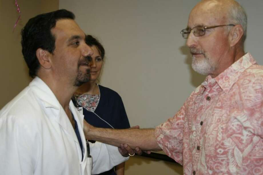 Larry Bernshausen with Dr. Rick Ganim held a party at Kingwood Medical Center May 8 where he celebrated his 70th birthday and his wife, Sally's, 60th birthday as well as have the chance to thank the Kingwood Medical Staff for all of their care and hard work when he was admitted to the hospital in January.