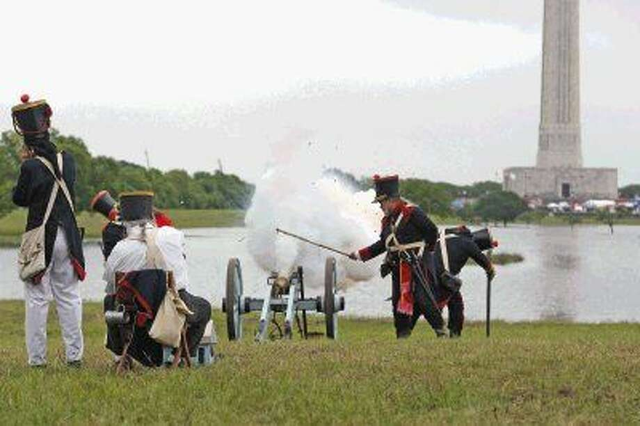 A group fires the cannon during the 2015 San Jacinto Day Festival and Battle Reenactment. Because the rain flooded the grounds the main reenactment was not held. The group did later hold smaller battles as the weather held out. Photo: Kar B Hlava