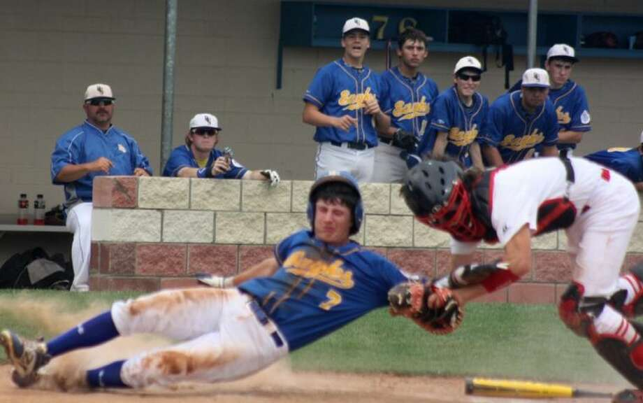 Pasadena-FBCA catcher Thomas Mills tags out Brazosport Christian's Tyler Bergen as Bergen was bidding to score in the fifth inning. It was one of two runners the Eagles lost at home plate, but it became a moot point in the 4-0 loss for the Warriors. Photo: Robert Avery