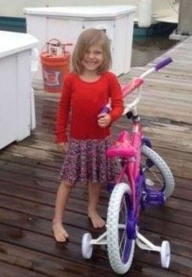"The search for a missing five-year-old Kemah girl came to a tragic end Thursday (April 23) after a searcher found the child's body under a dock near her dad's boat. The victim, identified as Fiona ""Kitty"" Carol was reported missing Wednesday (April 22) after she disappeared while her dad was doing some maintenance on his boat. Photo: File Photo"