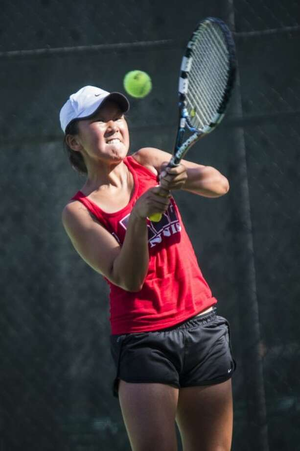 Clear Lake's Janice Shin makes a backhand return during the UIL State Tennis Tournament at the Penick-Allison Tennis Center. Shin won the Class 5A state girls' singles title in convincing fashion. Photo: ANDREW BUCKLEY