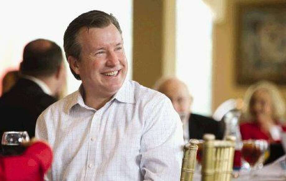 Jim McGrath laughs before speaking at the Montgomery County Republican Women's meeting at River Plantation Thursday.