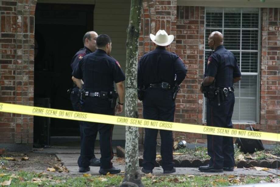 Harris County Precinct 4 Constables conduct their investigation on a home invasion in the Kenswick subdivision May 13, 2014.