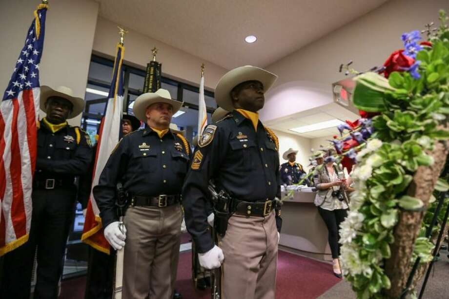 The Harris County Sheriff's Office Honor Guard stands at attention in front of a memorial wreath before the start of the Peace Officers Memorial Ceremony. Photo: Michael Minasi