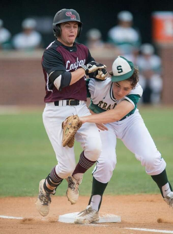 A Stratford infielder and a George Ranch baserunner collide at first base during Game One of the team's best-of-three Region III-4A playoff game last Thursday night at Stratford. The Spartans were wept in two games bringing their season to an end. Photo: Kevin B Long